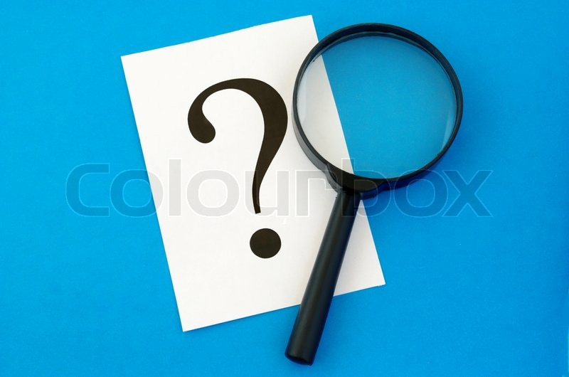 Stock image of 'A question mark on the paper and a magnifying glass'