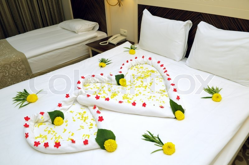 Bed suite decorated with flowers and towels stock photo for Bed decoration with flowers and balloons