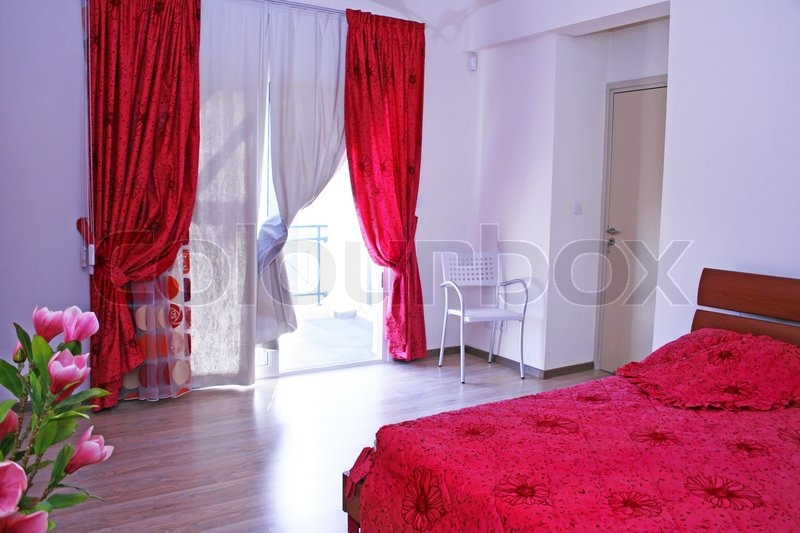 Bedroom with pink curtains, bedspread ... | Stock image | Colourbox