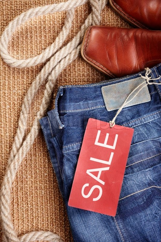 Red sale label on new denim jeans,selective focus | Stock Photo ...