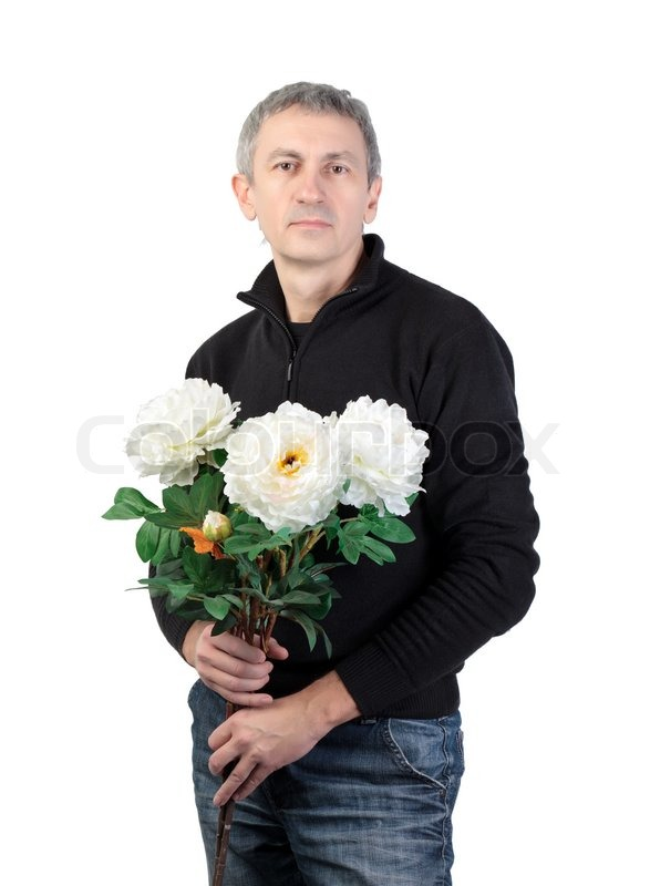 Man holding a bouquet of flowers on white background | Stock Photo ...