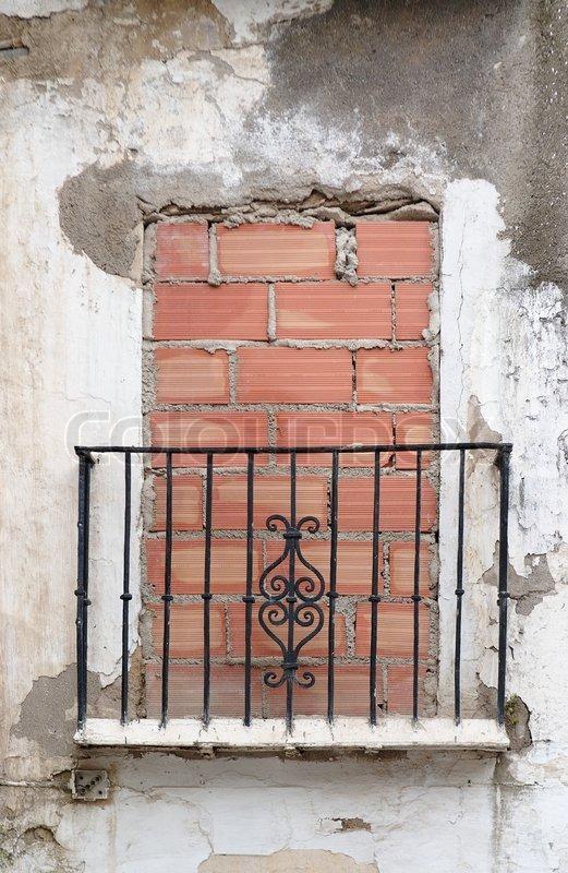 Old Balcony Door Blocked By Brick Wall Stock Photo