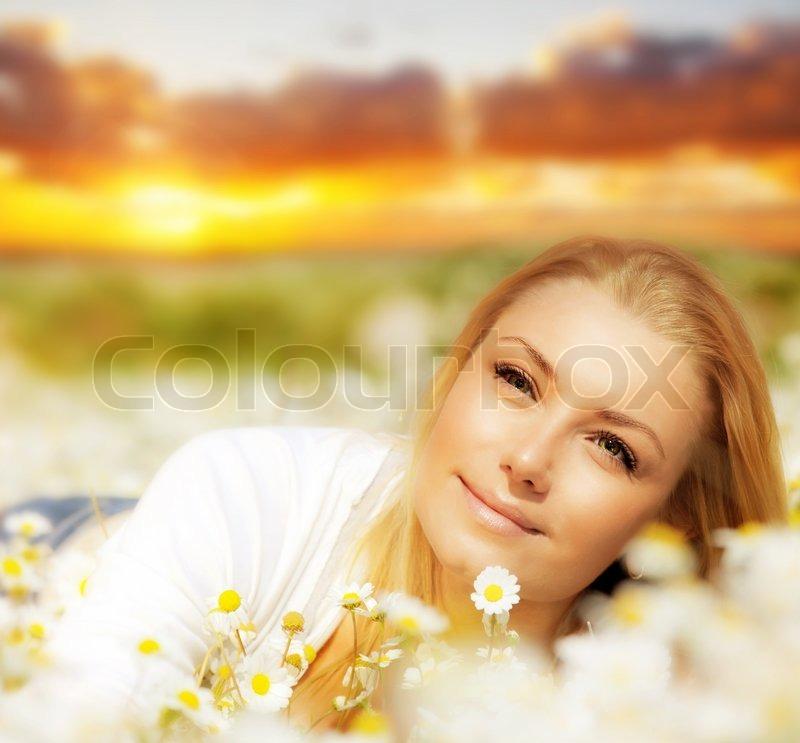 Happy Beautiful Woman Enjoying At Beach Stock Photo: Beautiful Woman Enjoying Daisy Field At ...