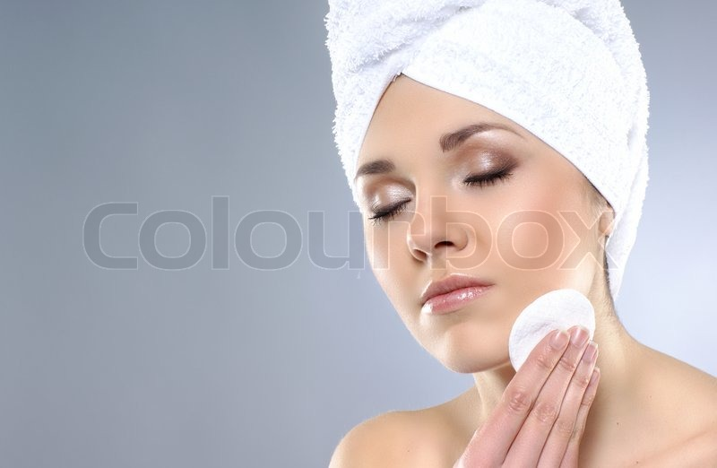 Young attractive woman in towel making the spa treatment, stock photo