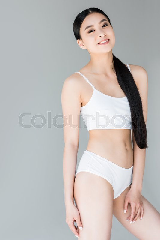Smiling Attractive Asian Woman In White Stock Image Colourbox