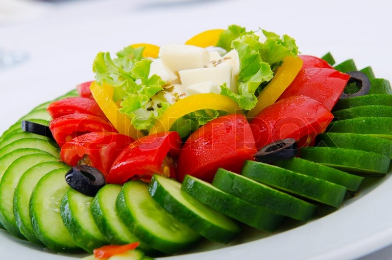 & Cucumber and tomato salad in plate | Stock Photo | Colourbox