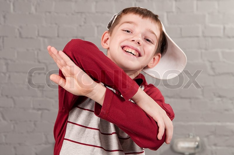 IMAGE(https://www.colourbox.com/preview/3441261-portrait-of-boy-10-years-with-crossed-arms-in-the-attitude-of-hip-hop-dancer.jpg)