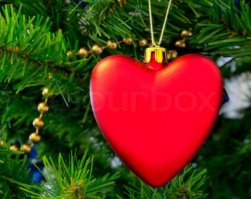 The christmas tree decoration in form of red heart