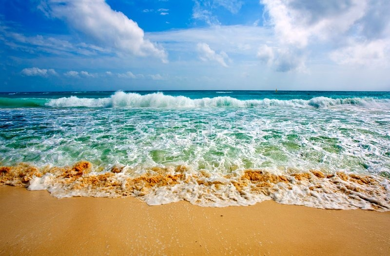 Stock image of 'Waves on beautiful golden beach'