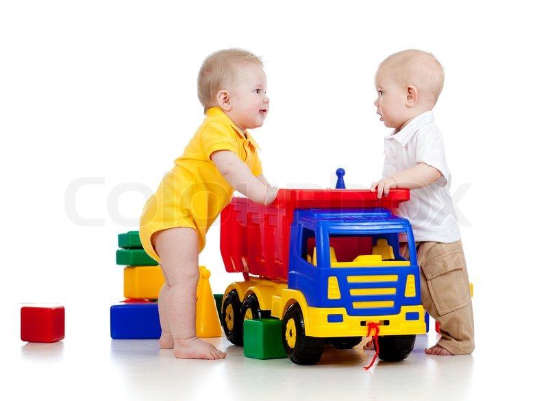 Two little children playing with color toys | Stock Photo | Colourbox