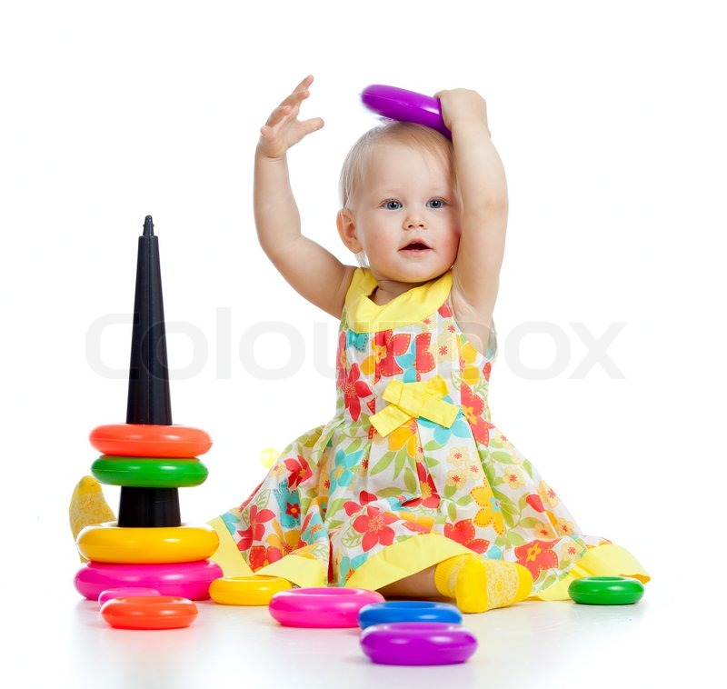 ... baby playing with color developmental toy | Stock Photo | Colourbox
