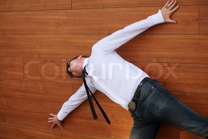 Yuong man in despair lying on the floor stock photo for To floor someone