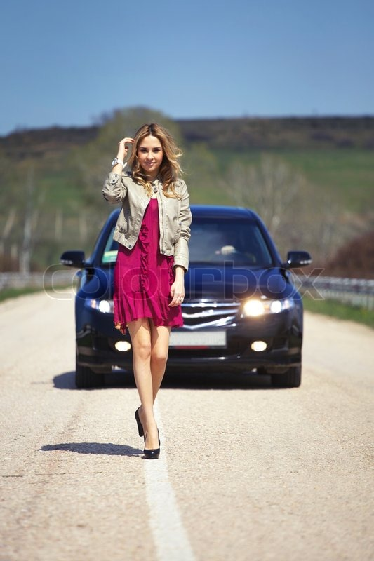 Young Beautiful Girl Going On The Road With The Car