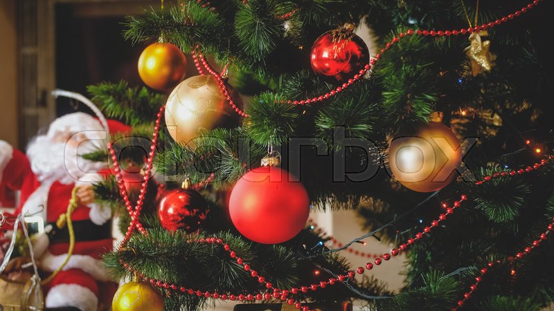 Stock image of 'Beautiful winter holidays backgorund with adorned Christmas tree and SAnta on sleighs'