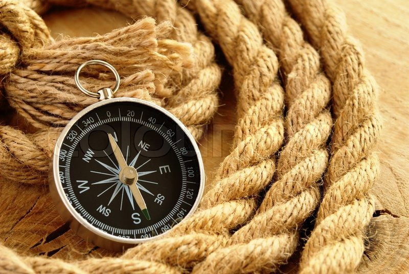 Black compass and marine rope | Stock image | Colourbox