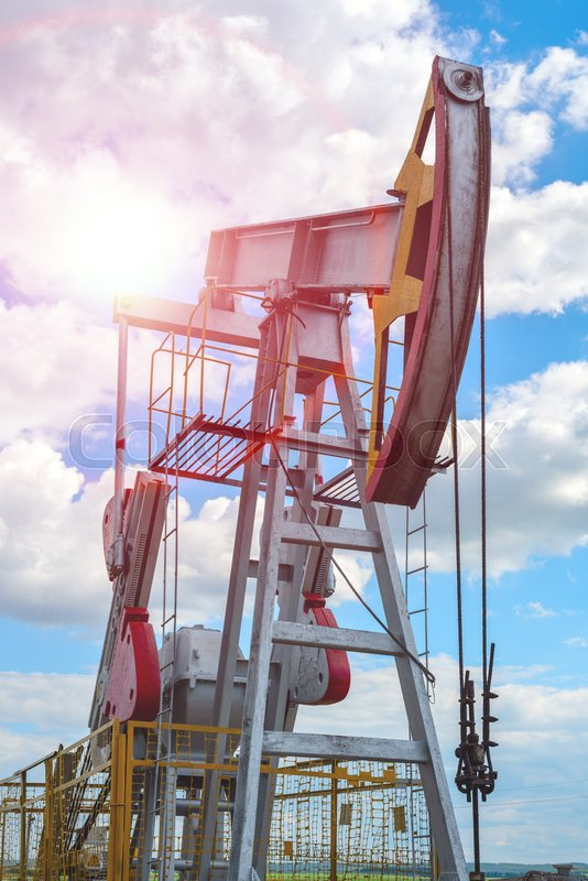 Oil and natural gas production tower with bright sunlight, glare, stock photo
