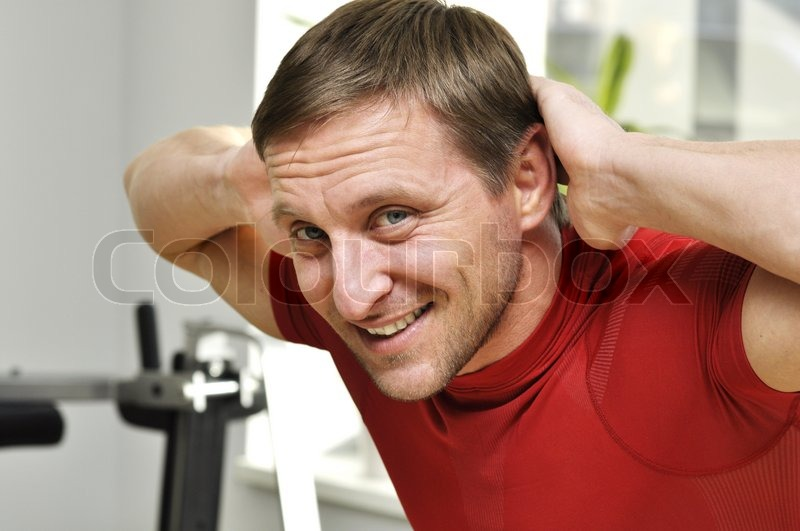 Fitness men exercising in the gym, stock photo