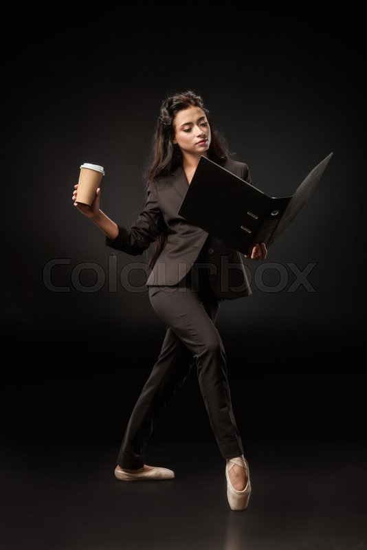Attractive businesswoman in suit and ...