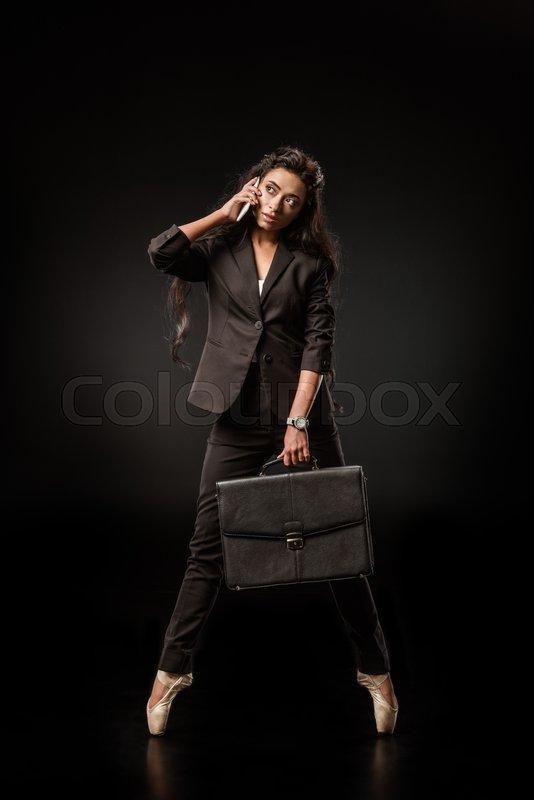 Stylish businesswoman in formal wear ...