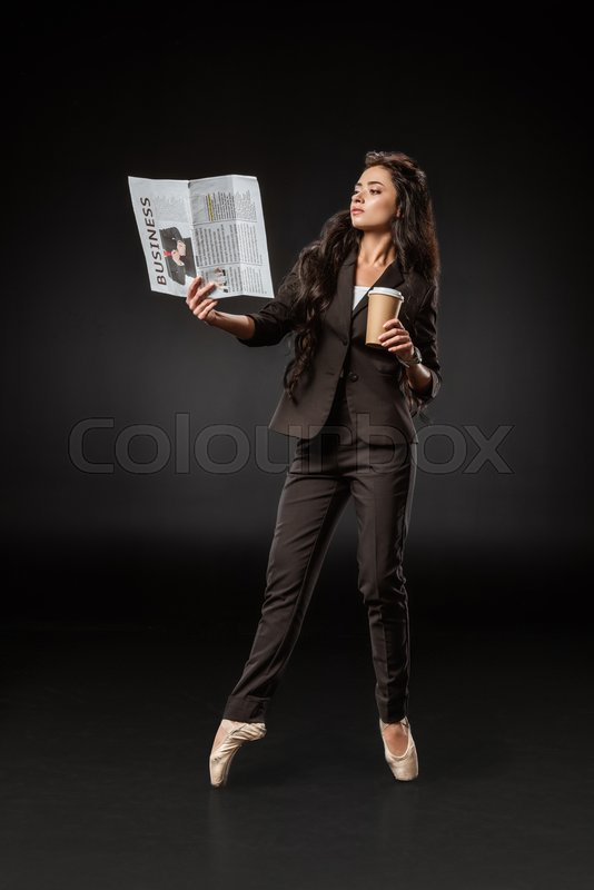 Stylish businesswoman in ballet shoes ...