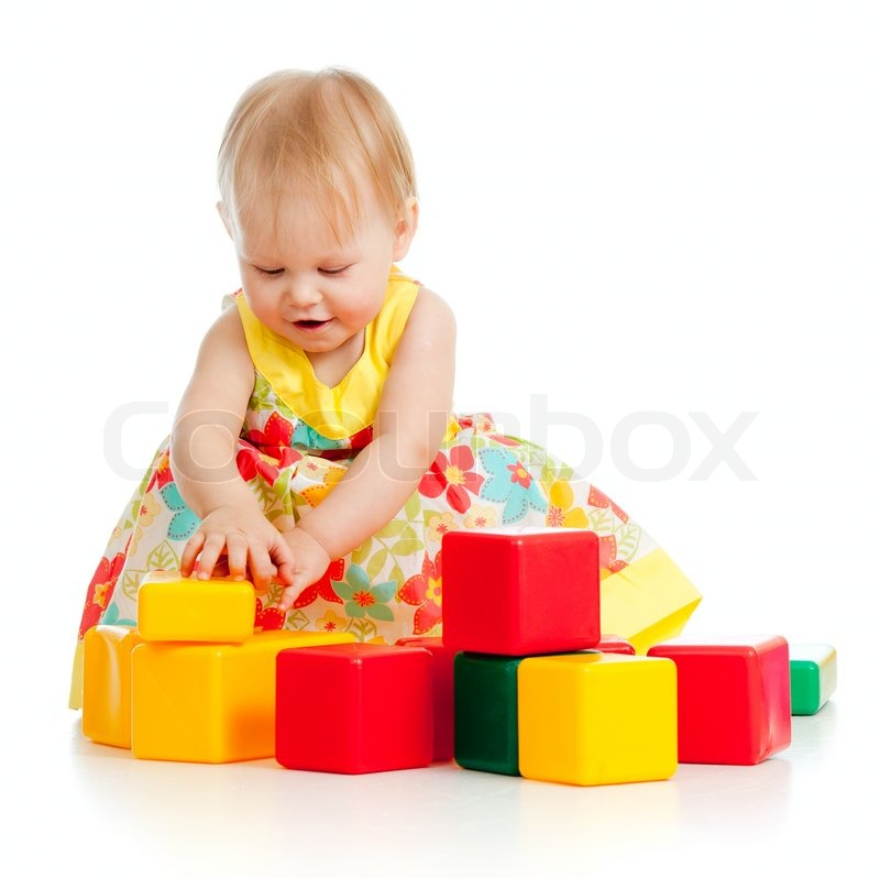 Child playing with building blocks | Stock Photo | Colourbox