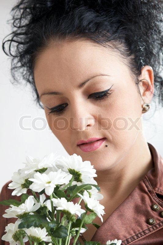 An image of nice woman with flowers, stock photo