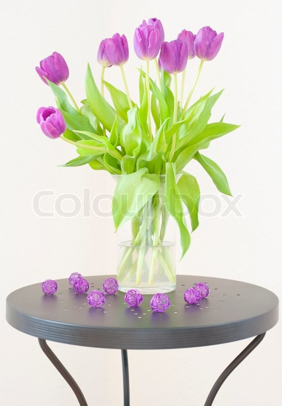 Bouquet Of Purple Tulips In A Glass Vase On A Black Coffee Table Extraordinary Black And White Decorative Balls