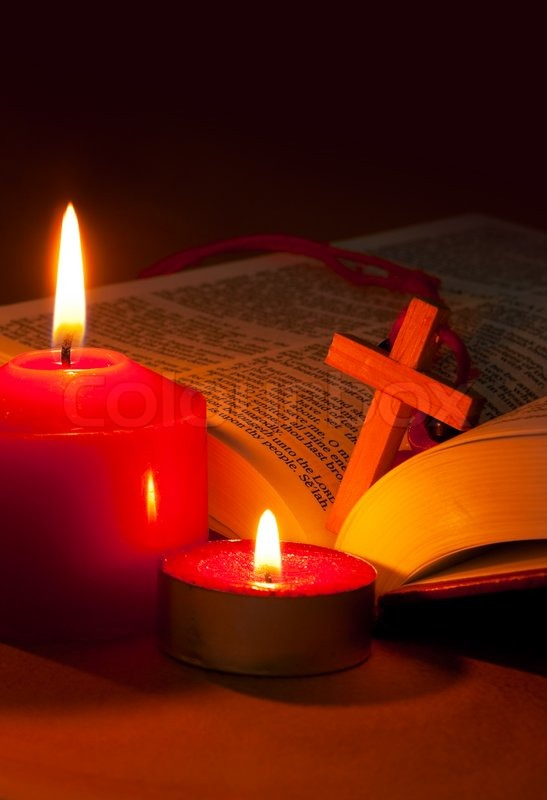 Open Bible With Cross And Burning Red Stock Photo