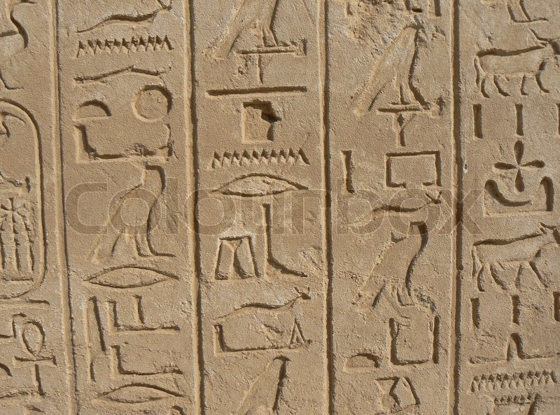 Ancient egyptian hieroglyphics and reliefs stock photo