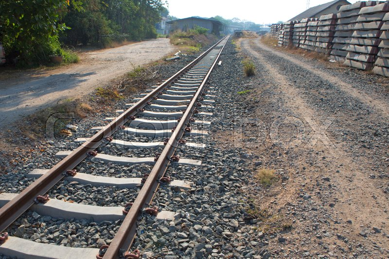 Railroad with vanishing point, parallel and infinity, railway background, stock photo