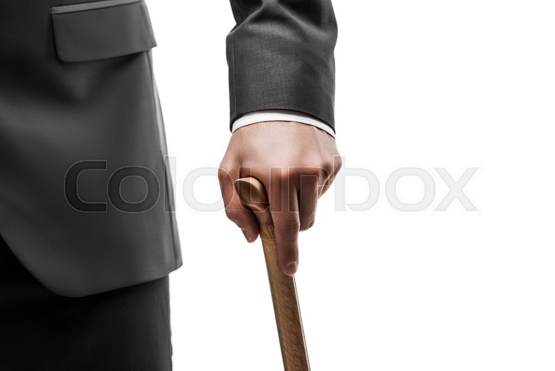 Businessman in black suit hand holding wooden walking cane stick white  isolated d4baf4f50