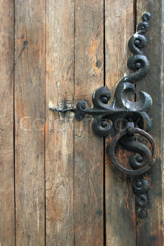 Vintage Wooden Door With Forged Handle Stock Photo