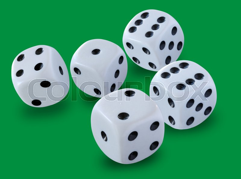 Five white dices size thrown in a craps game, yatzee or any kind of dice game against a green background , stock photo