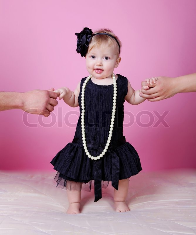 Little Girl In Black Dress In Studio Stock Photo Colourbox