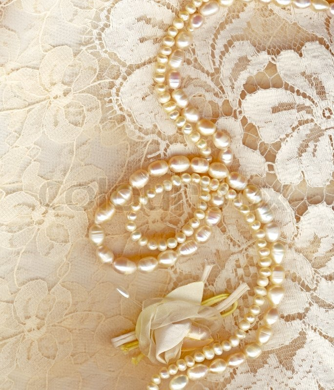 Wedding background with cream silky decoration accessories, lace and ...