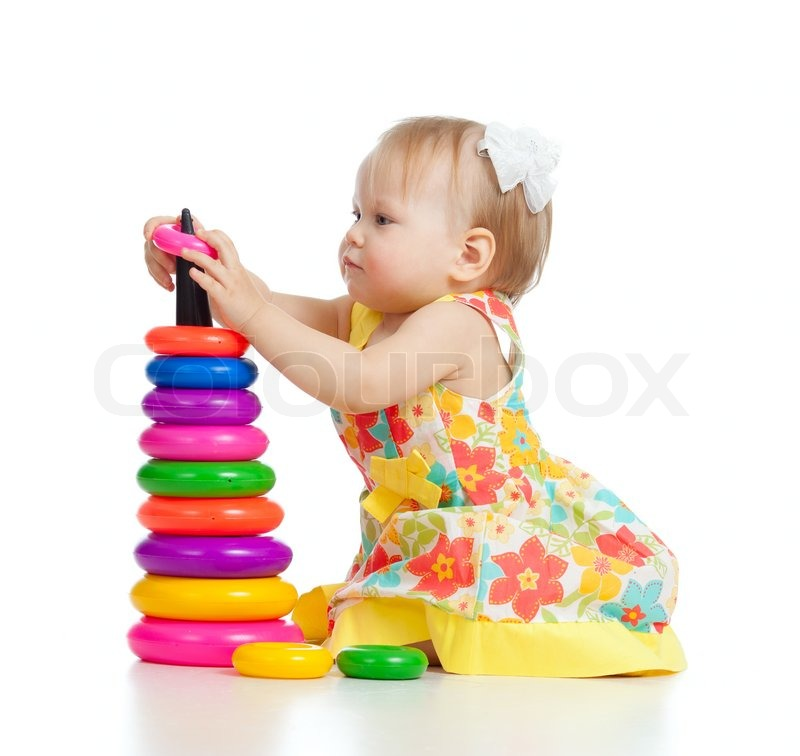 Pretty little girl playing with color toy stock photo
