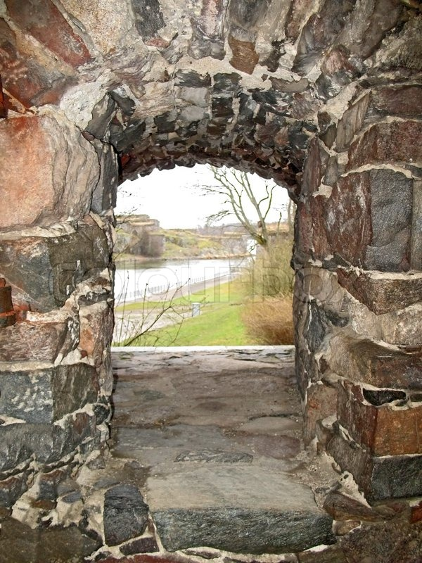 View Through Stone Window In The Wall Stock Photo