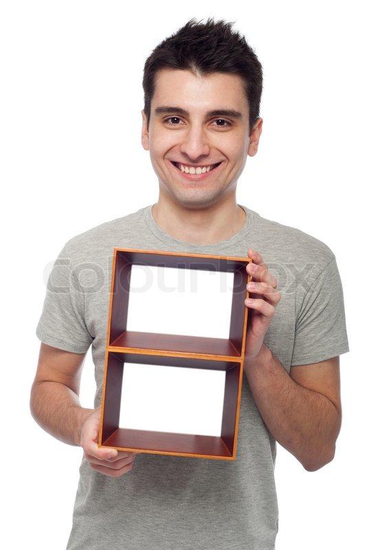 Man holding frame | Stock Photo | Colourbox