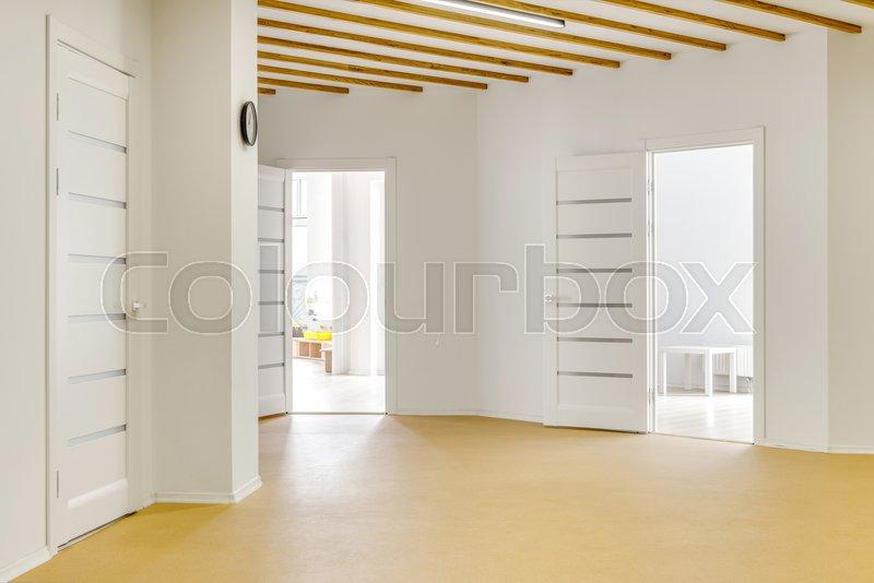 Empty hallway with open doors in modern stock photo colourbox