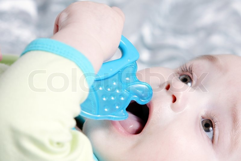 Cute baby with a blue fish teether stock photo colourbox for Blue fish dental