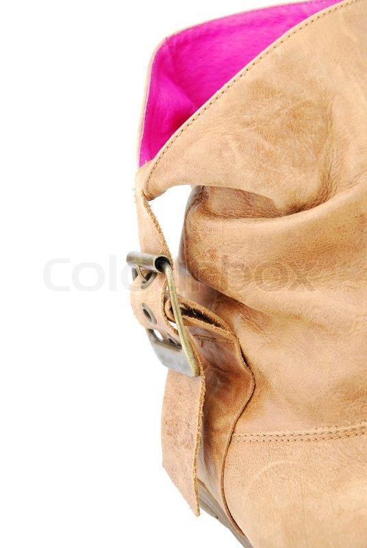 757b54b53f13 Stock foto af  Close- up af en kvinder læder brun boot på hvidt