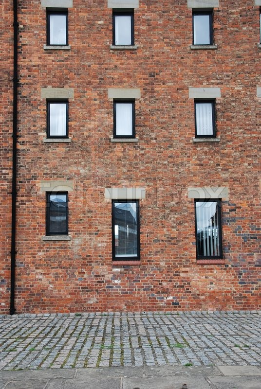 Brick building facade stock photo colourbox for Brick facade house