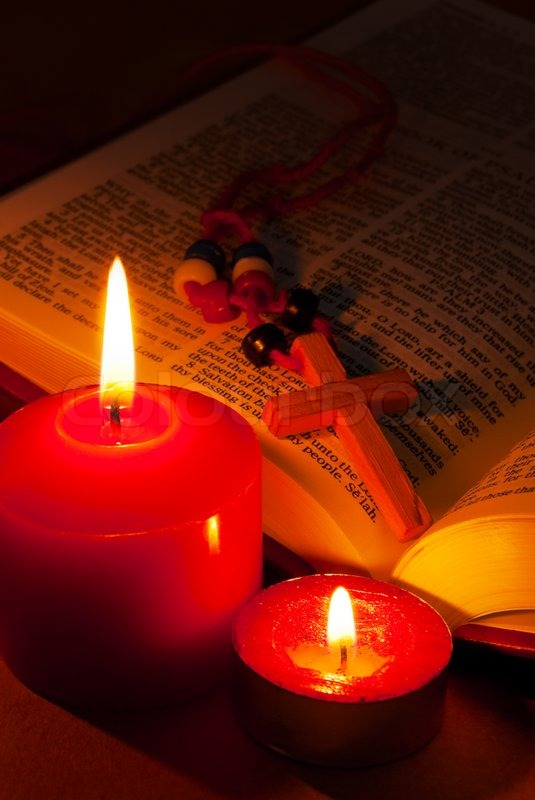 Open Bible With Cross And Burning Candles Stock Photo