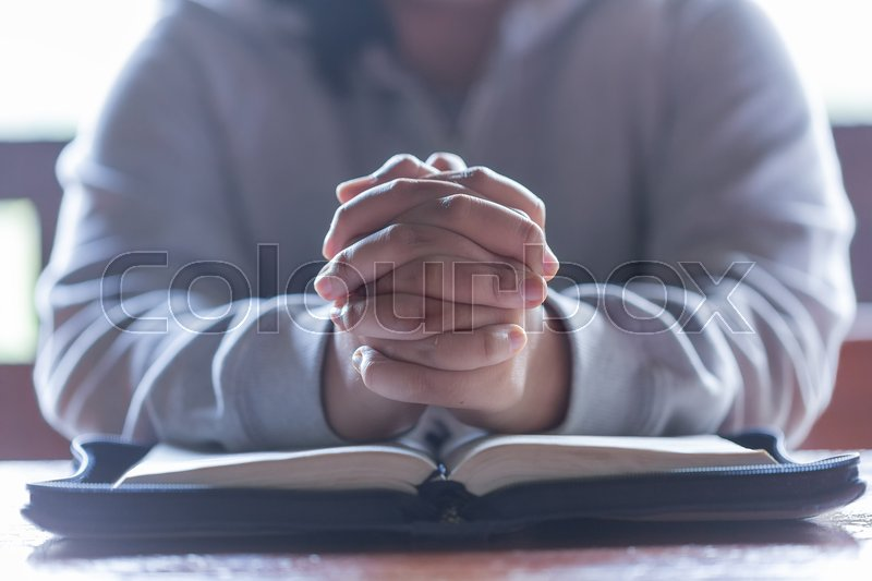 Teenager woman hands praying to god with the bible. Woman Pray for god blessing to wishing have a better life. begging for forgiveness and believe in goodness. ..., stock photo