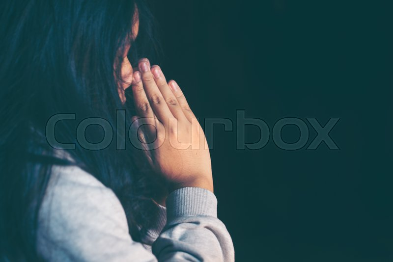 Teen girl hands praying to god with the bible. Girl Pray for god blessing to wishing have a better life. begging for forgiveness and believe in goodness. Christian ..., stock photo
