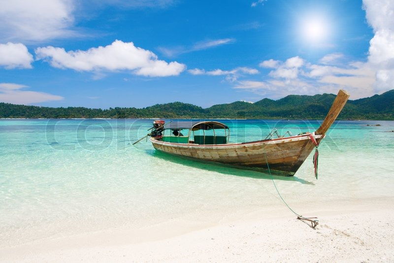 Longtail boat and beautiful beach with white sand | Stock ...