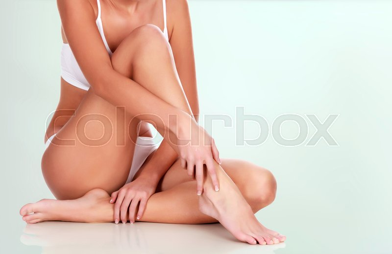 Young woman with slim body and smooth clean skin. Laser hair removal concept, stock photo