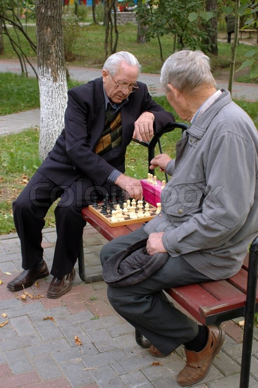 Two Old Men Playing Chess In The Park 2 Stock Photo