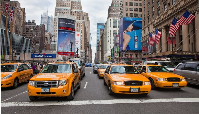 New York May 28 Group Of Yellow Taxi Cabs Rush Tourists Around Manhattan 2010 In City Ny Stock Photo