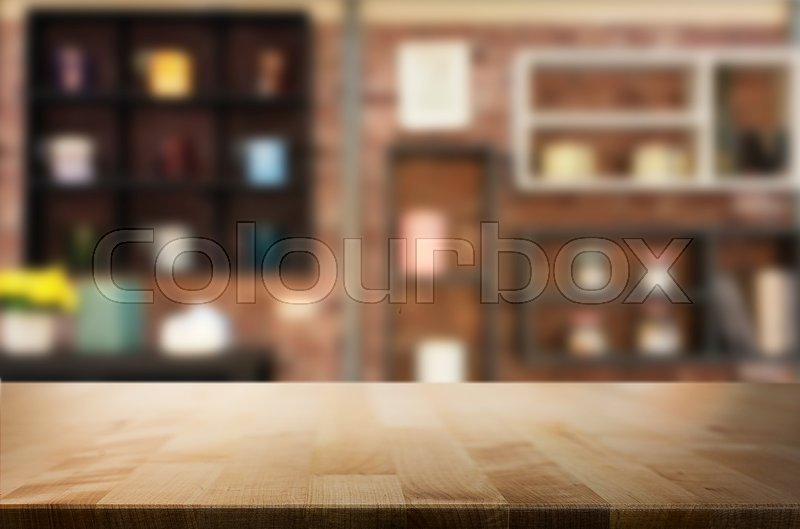 Wooden board empty Table Top And Blur Interior over blur in coffee shop Background, Mock up for display of product, stock photo